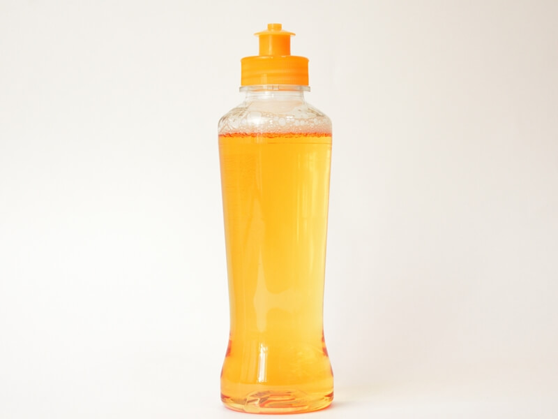 オレンジ色の食器用洗剤